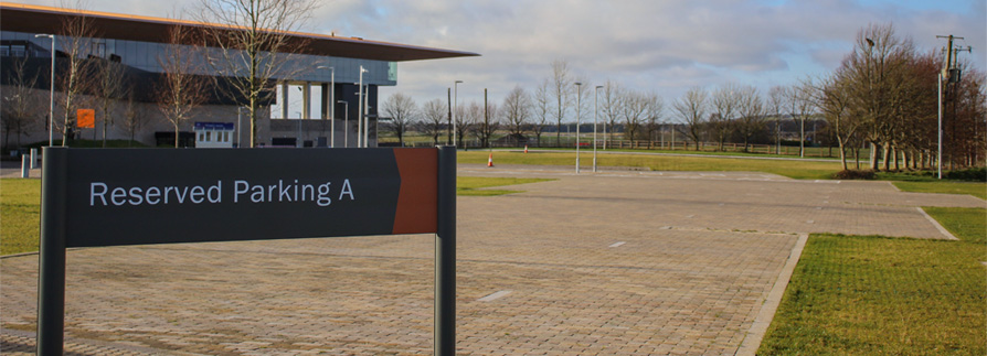 A wayfinding sign shows the way to special parking bays at The Curragh Racecourse