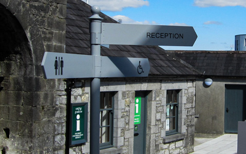 We personalised this finger post wayfinding sign by powdercoating it in brand colours and adding a decorative finial