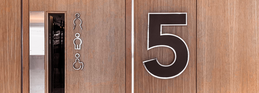 Stainless_Steel_Floor_Number_and_bathroom_icons_at_HubSpot_House_Dubli